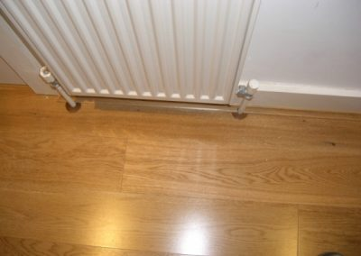 Oak flooring under radiator