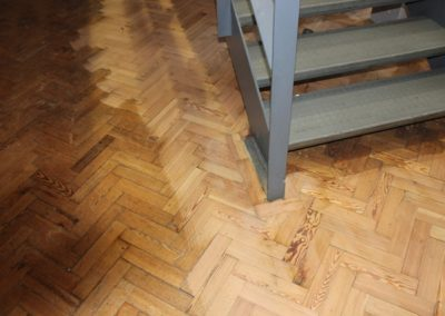 Pine wooden floor by staircase